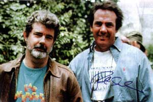 George Lucas in                 his Zak T-shirt (with producer Rick McCallum)